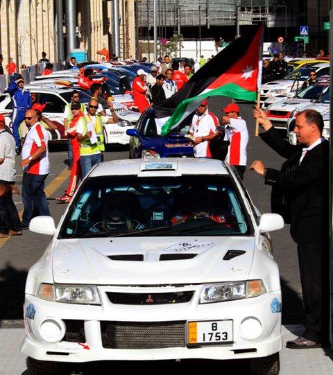 HRH Prince Feisal Al-Hussein flags Suhail Al-Jariri and Maysoon Jayousi from the start of the 2014 Jordan Rally..JPG