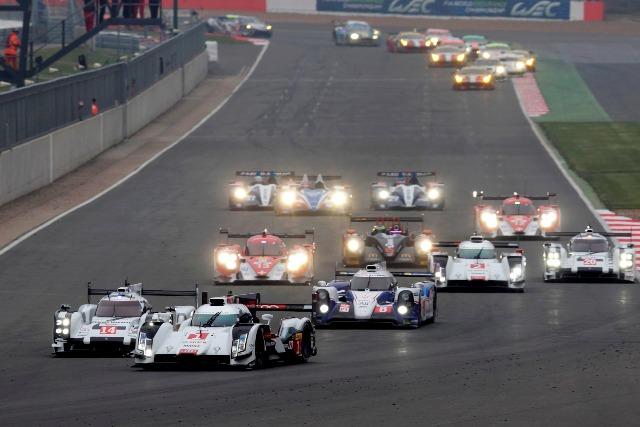In 2014, three car manufacturers fight for victories with their hybrid race cars – pictured is Audi in front of Porsche and Toyota.jpg